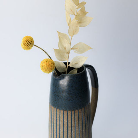 navy jug with dried flowers