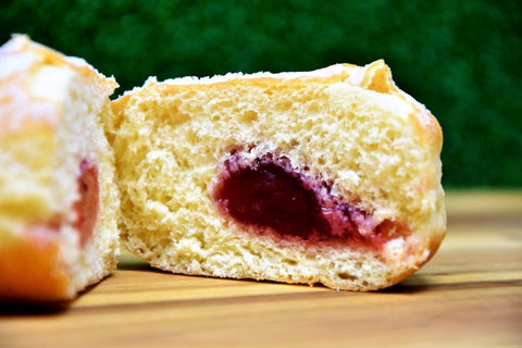 Jam oozing out of doughnut