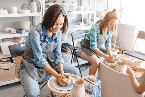 TWO WOMEN AT A POTTERY CLASS