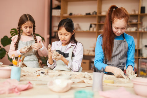 children making pottery in pottery class