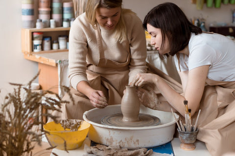 potters making a vase on the wheel