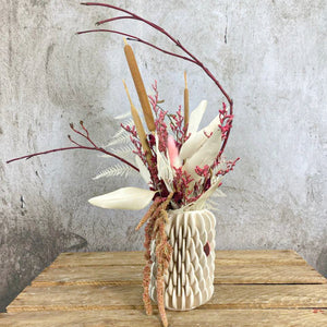 Disc vase with dried flowers