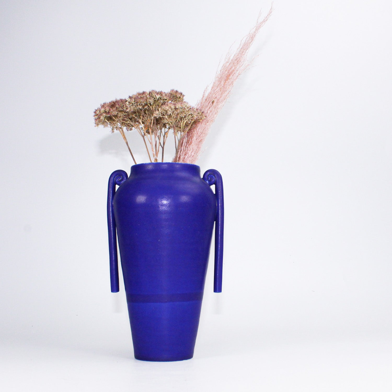 Ceramic cobalt blue Greek vase with flowers