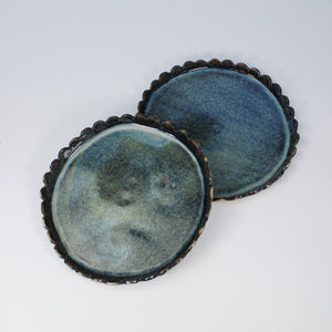 Pair of blue ceramic side plates with scalloped edges