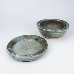 Blue pottery dog food bowl with matching dog water bowl