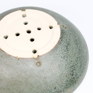 Bottom of green ceramic soap dish