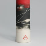 Load image into Gallery viewer, Bottom of single stem porcelain red, white and black vase. Red potter's mark at bottom.