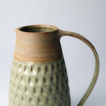 Load image into Gallery viewer, Top detail of stoneware jug with large handle. Top of jug has brown stripe