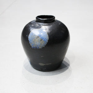 Small black vase with blue detail