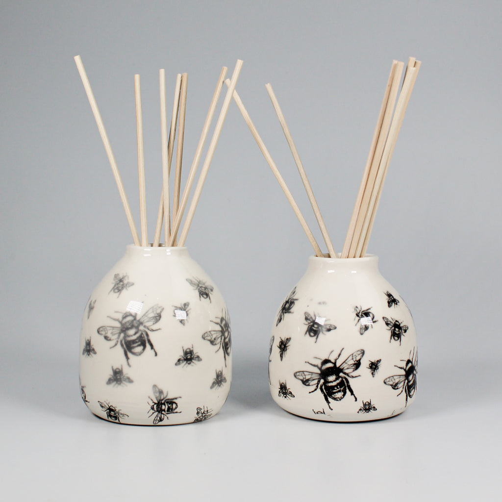 Pair of ceramic white reed diffusers with black bee pattern