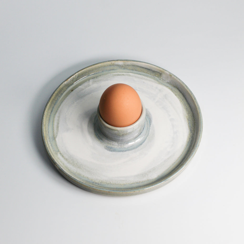 Ceramic egg cup plate with egg in