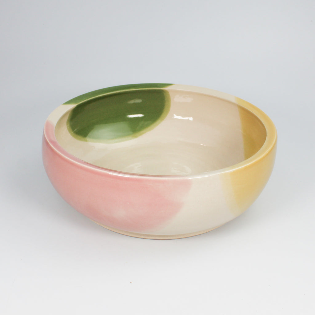Pink, white, green and yellow large pottery dog bowl