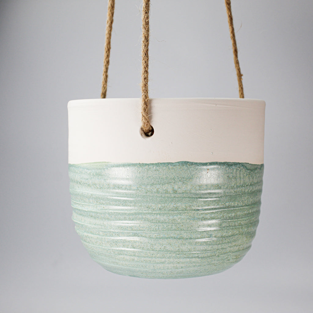 White and pale green ceramic hanging plant pot