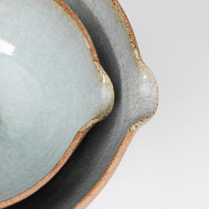 Close up of pouring lip of two ceramic pouring bowls