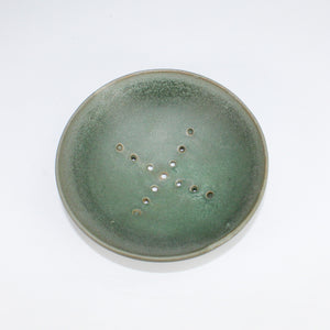 Dark green ceramic soap dish with draining holes