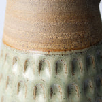 Load image into Gallery viewer, Close up of neck of green and brown stoneware jug.