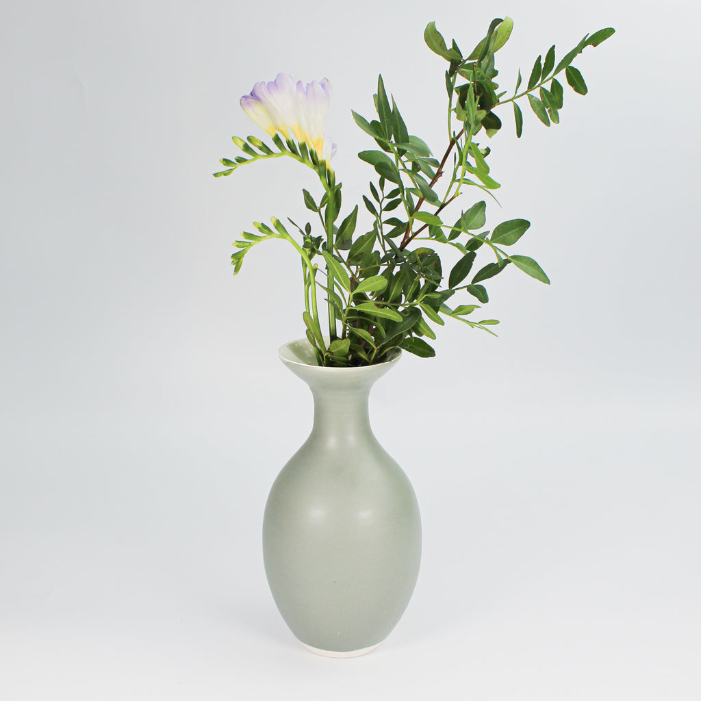 Grey ceramic narrow neck pottery vase with flowers in