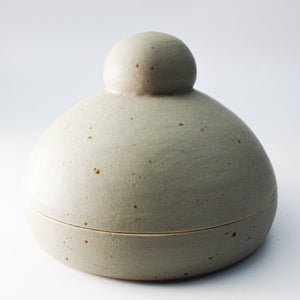 Grey pottery butter dish with lid on