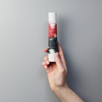 Load image into Gallery viewer, Hand holding single stem porcelain red, white and black vase