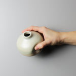Load image into Gallery viewer, Hand holding small ceramic wasi sabi vase