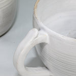 Load image into Gallery viewer, Close up of handle of off white ceramic cup