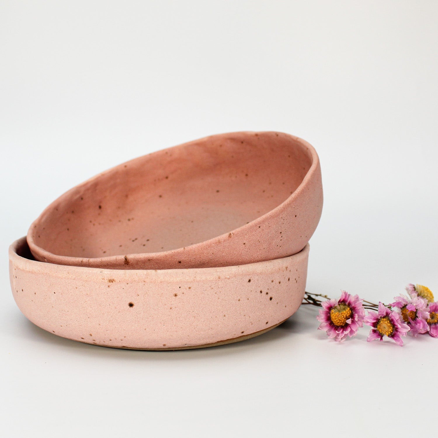 Pair of pink speckled dishes