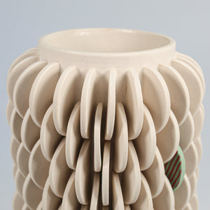 Single patterned disc vase