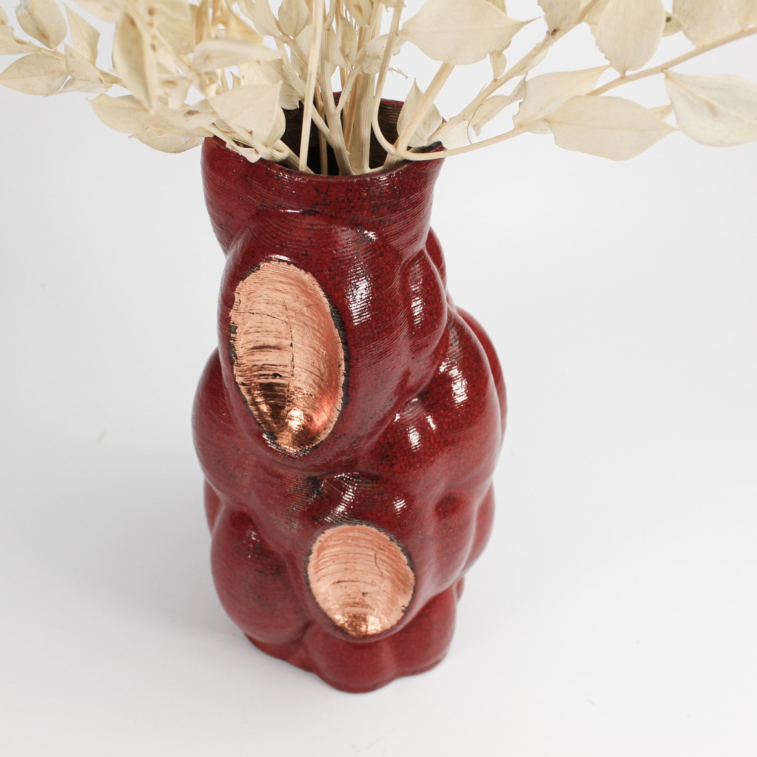 3D printed pottery red and gold vase with dried flowers in