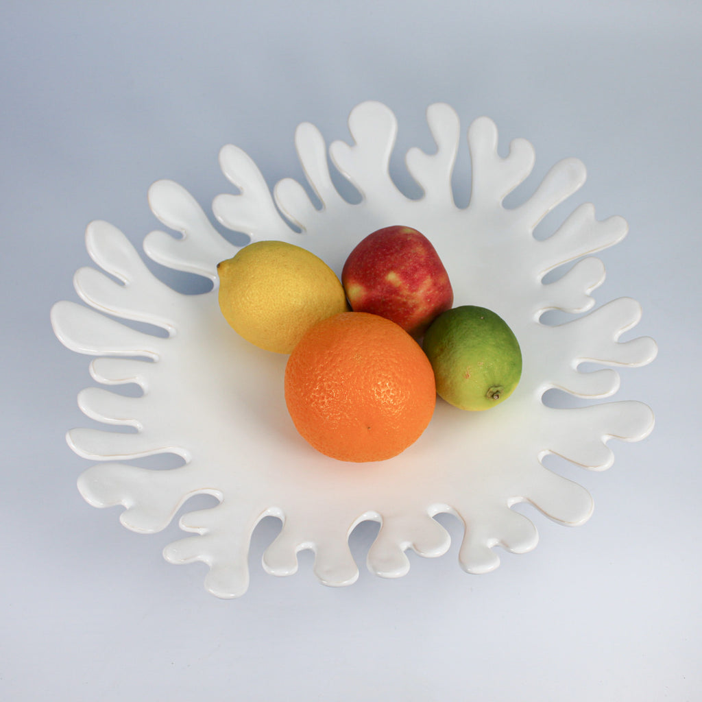 High gloss white ceramic fruit platter with fruit in