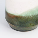 Load image into Gallery viewer, Bottom detail of large stoneware vase. Green and bronze detailing.