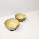 Load image into Gallery viewer, Set of two ceramic pouring bowls. Natural brown outer with mustard glazed inner.