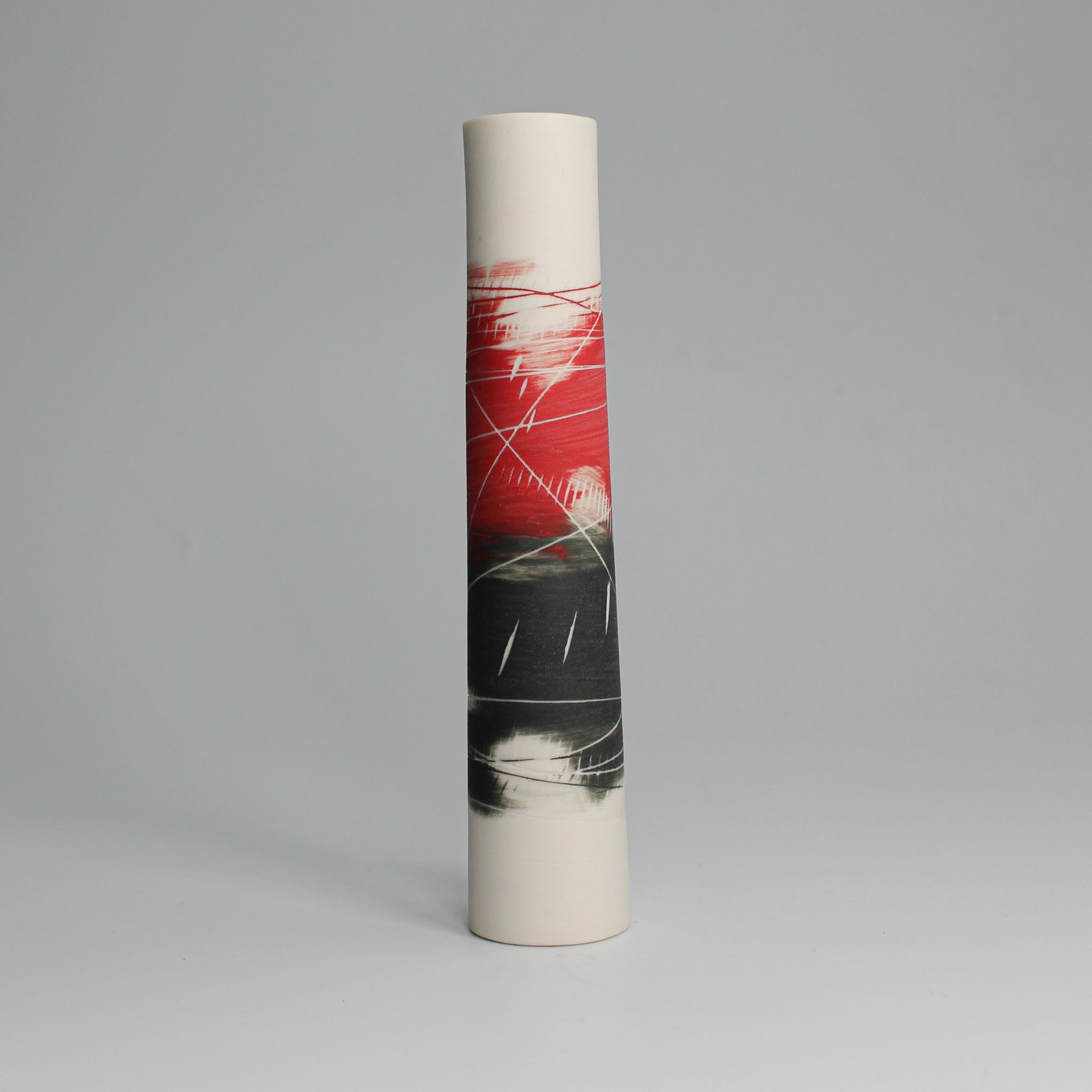 Pottery red, white and black single stem vase