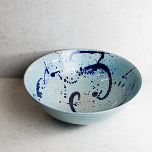 Extra large baby blue ceramic salad bowl with darker blue splatters
