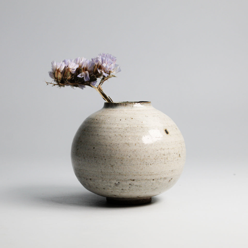 Mini pottery moon jar in speckled white with small flowers in
