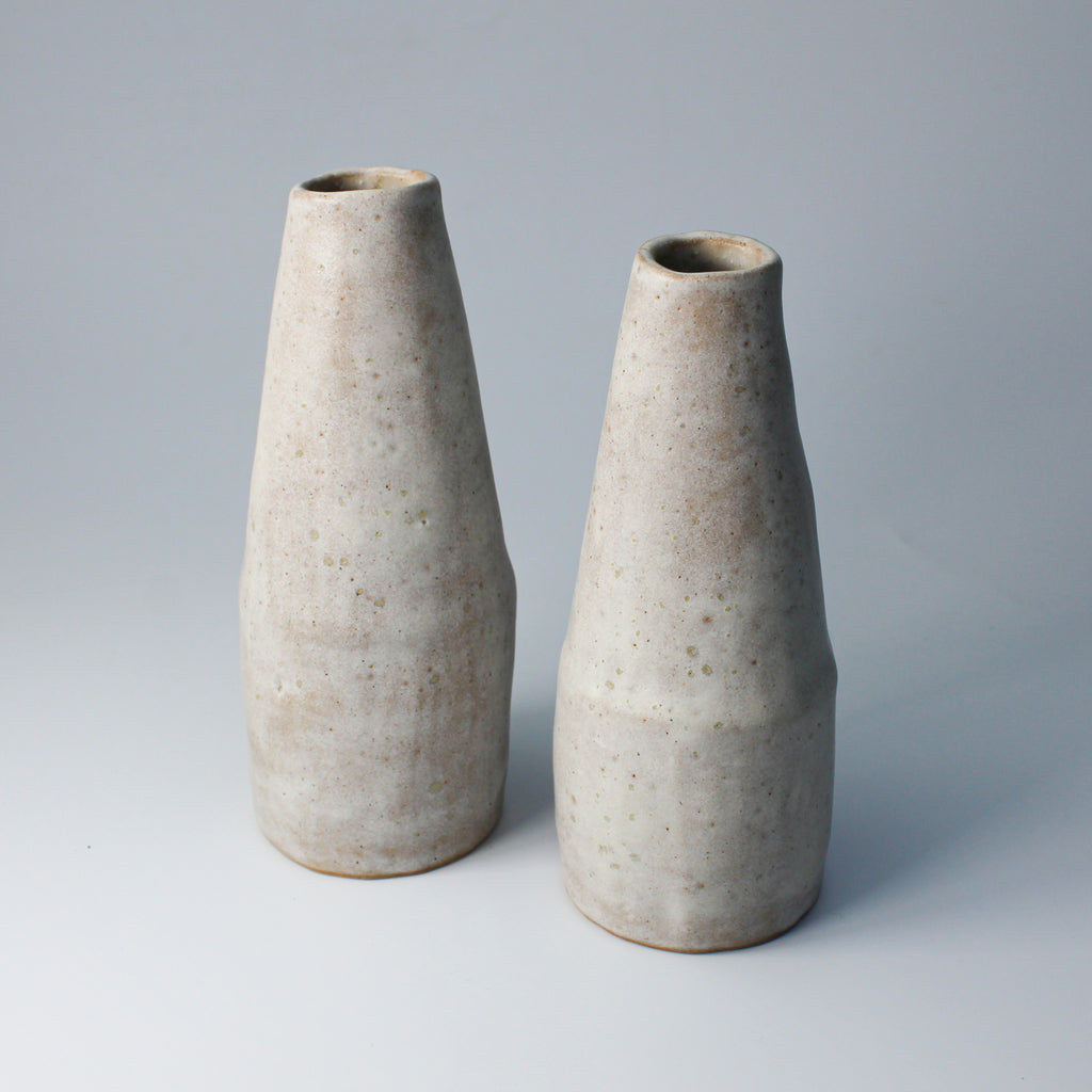 Pair of light grey speckled pottery bud vases