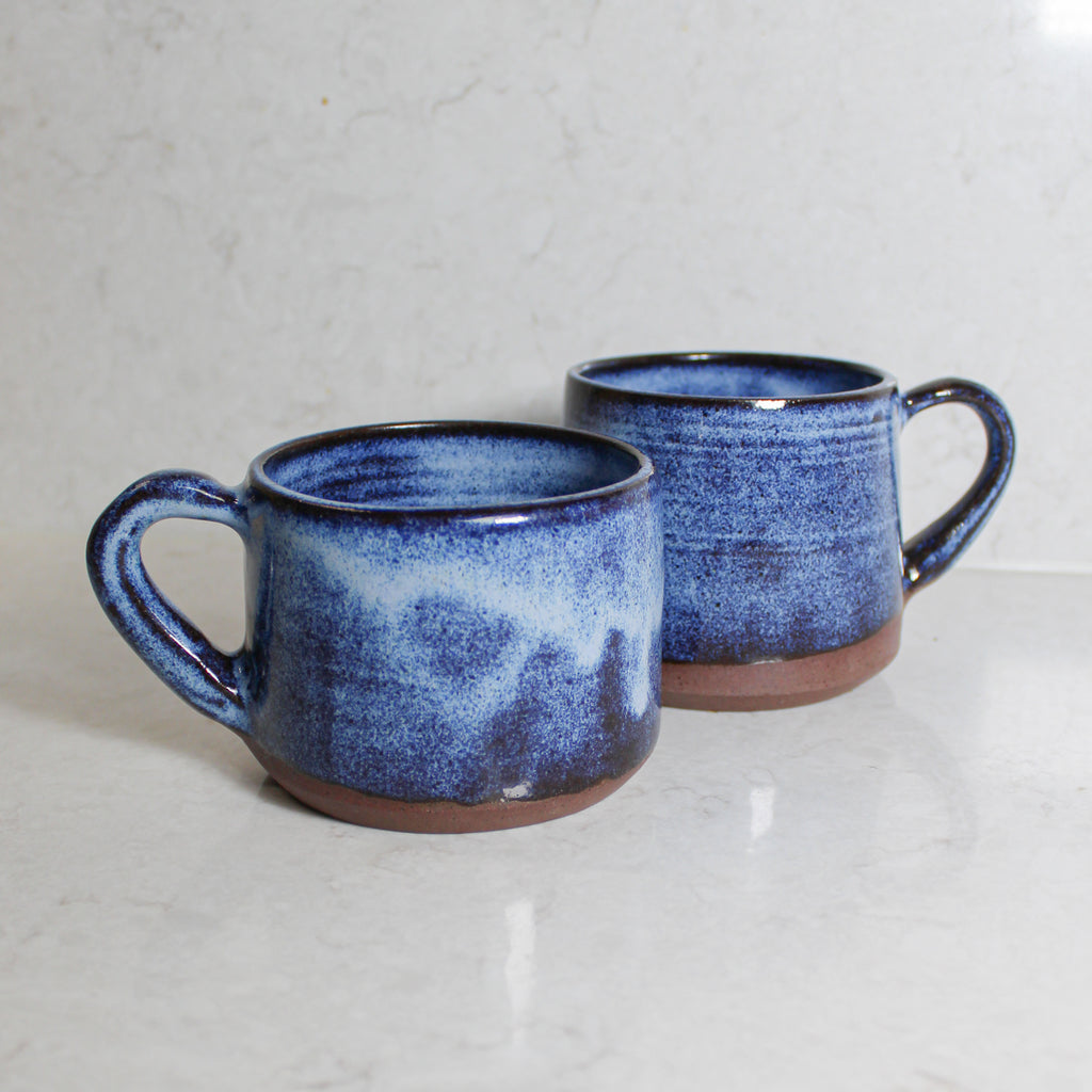 Two ceramic mugs with moody blue glaze