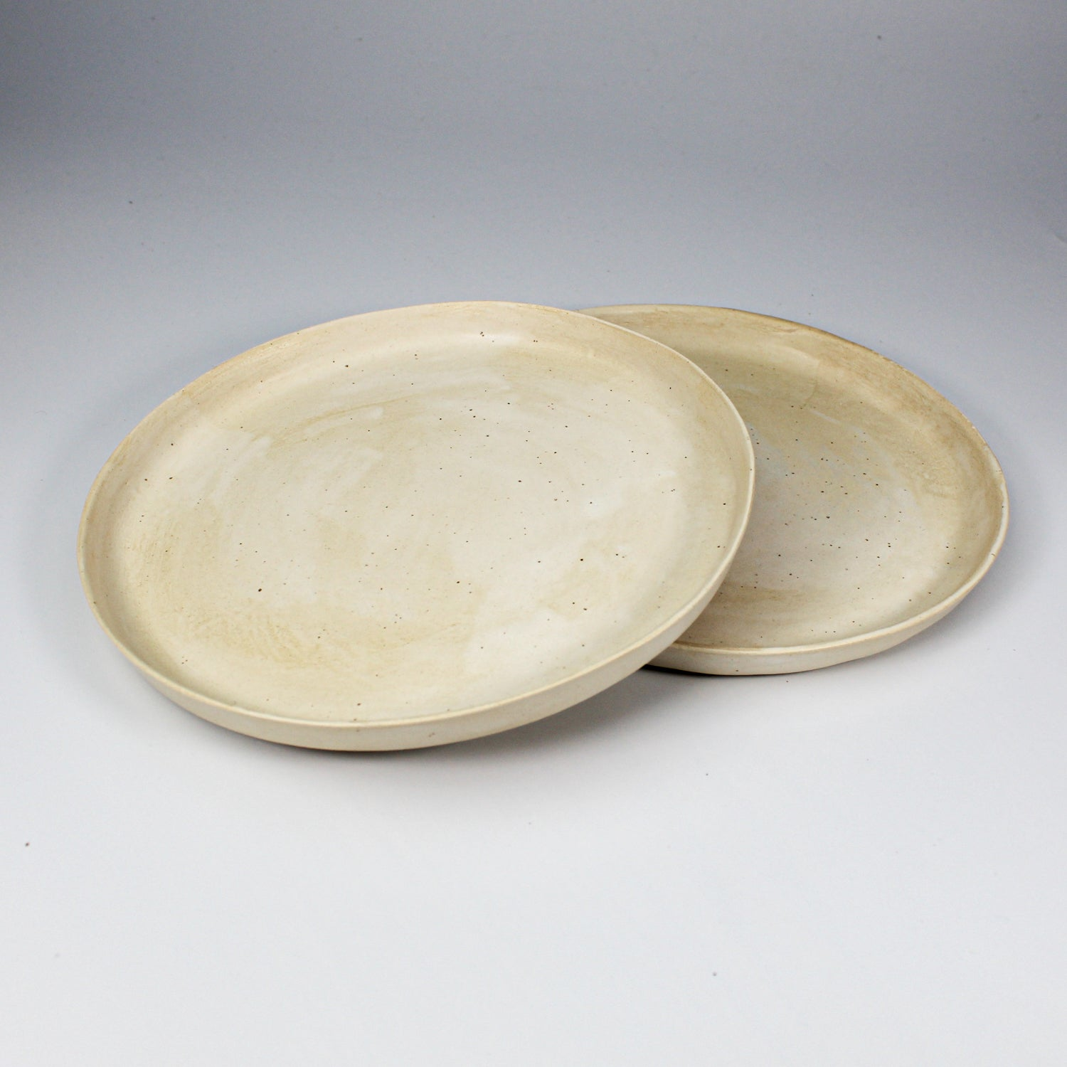 Pair of cream speckled side plates