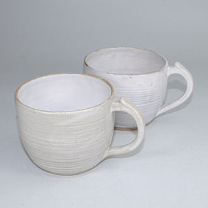 Pair of off white ceramic cups