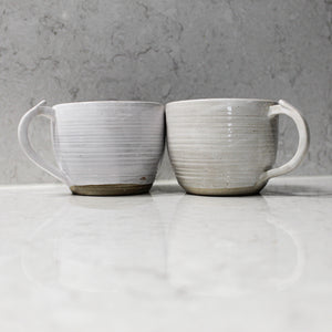 Pair of ceramic cups side by side