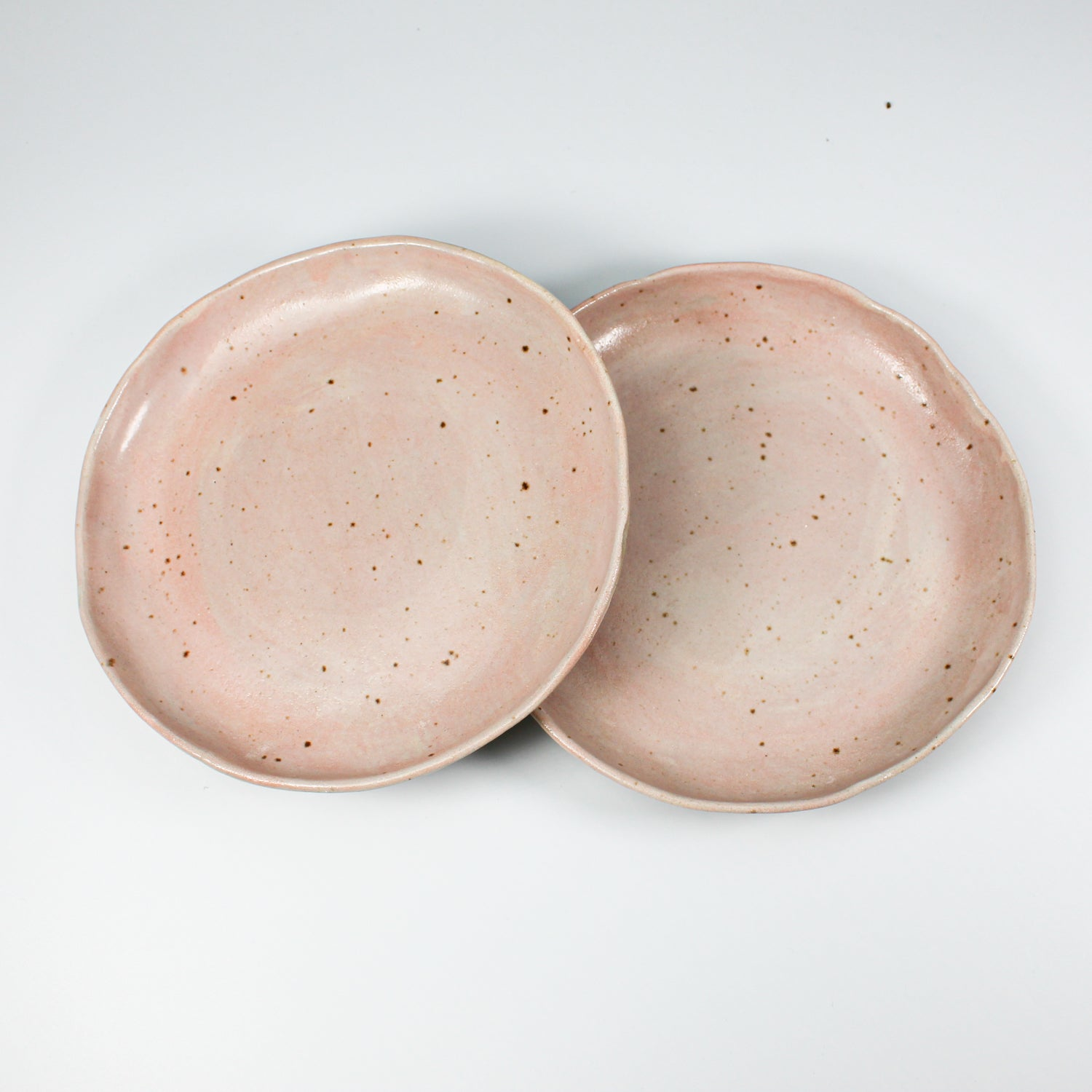 Pair of pink speckled ceramic side plates