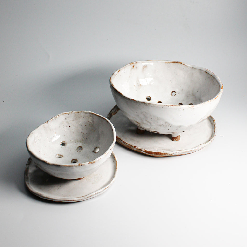Pair of white pottery berry bowls with plates