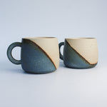 Load image into Gallery viewer, Pair of ceramic mugs in with half blue and half white glaze