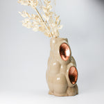 Load image into Gallery viewer, 3D printed pottery stone and copper leaf vase with white dried flowers in