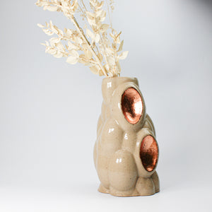 3D printed pottery stone and copper leaf vase with white dried flowers in