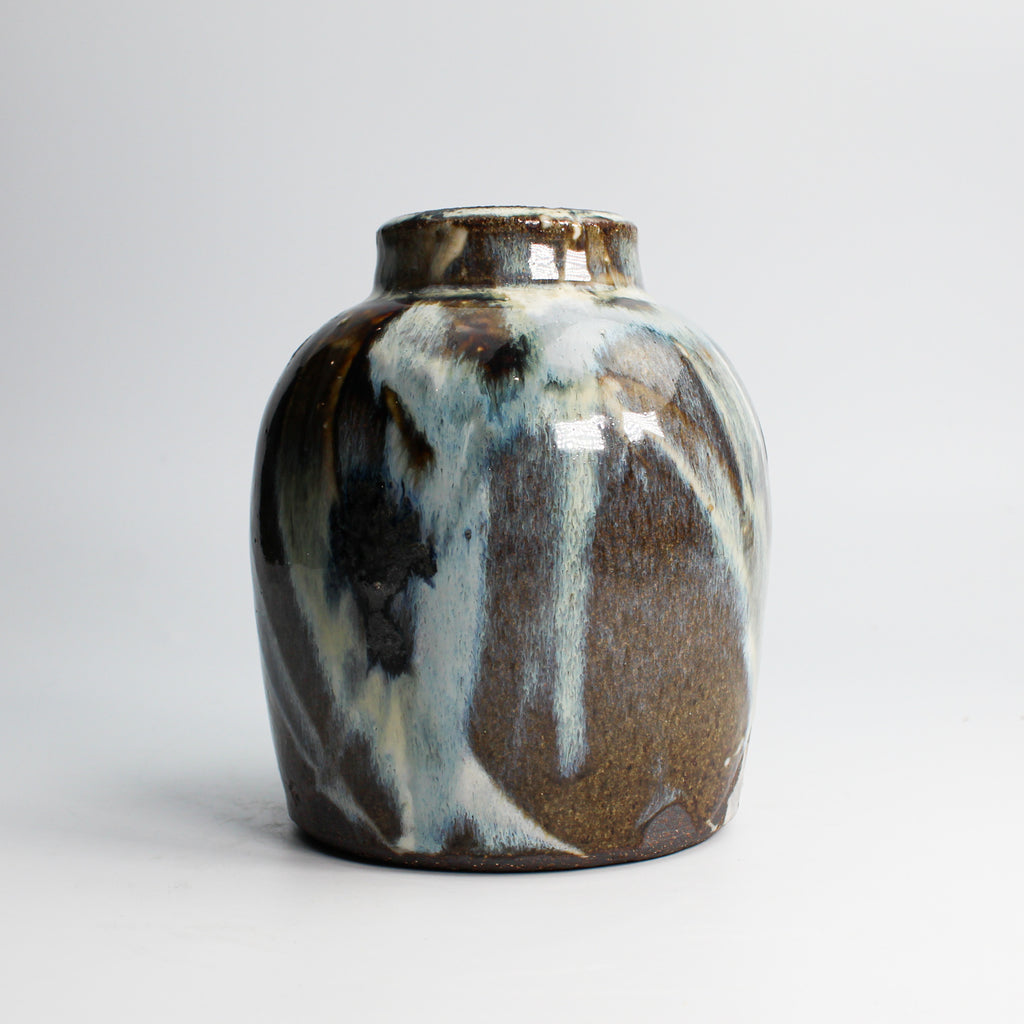 Small brown and blue high gloss glazed pottery vase