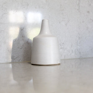 Small off-white bottle vase