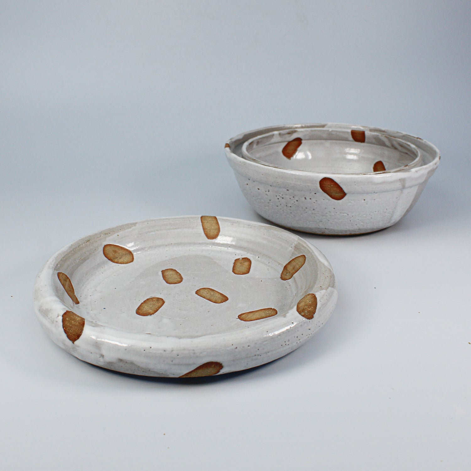Pottery spotted dog food bowl and matching dog water bowl
