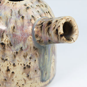 Close up of spout of pottery pourer. Beautiful marbled glaze.