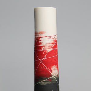 Top of white, red and black pottery single stem vase