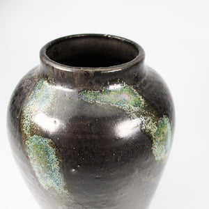 Top of small black and green pottery vase